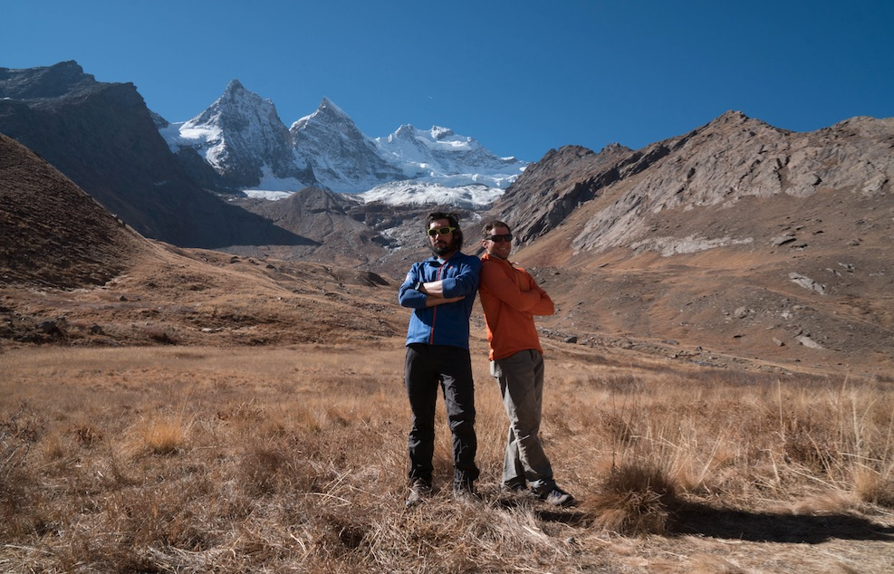 Villanueva (left) and Rousseau at base camp. Rungofarka is the center peak in the background. [Photo] Tino Villanueva