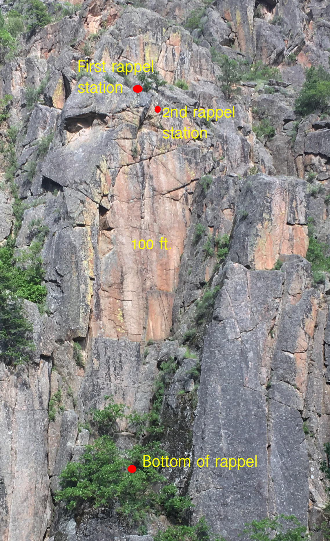 Overview of the Pink Face in No Name Canyon near Glenwood Springs, Colorado: The highest red dot indicates the location of the first rappel where the Escaper failed to activate. The second dot marks the second, free-hanging rappel station. [Photo] Derek Franz