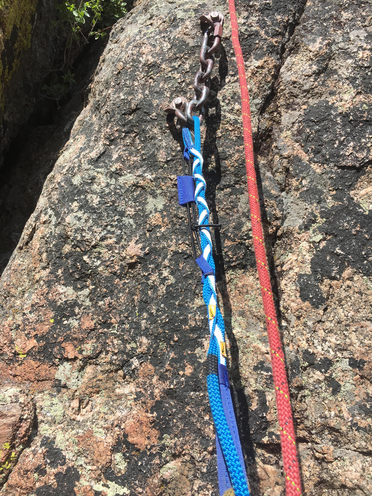 The second rappel station on the Pink Face was free-hanging and was perfectly ideal for retrieving ropes after a rappel. Again, the red rope was used as a backup. [Photo] Derek Franz