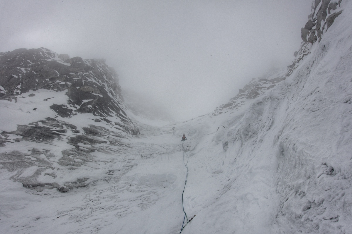 John leading during our first day of climbing. Weather started to change. [Photo] Benjamin Billet