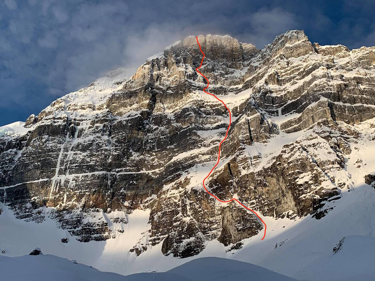 The east face of Mt. Fay with the line of The Sound of Silence (M8 WI5, 1100m) marked in red. [Photo] Courtesy of Ines Papert, Luka Lindic and Brette Harrington