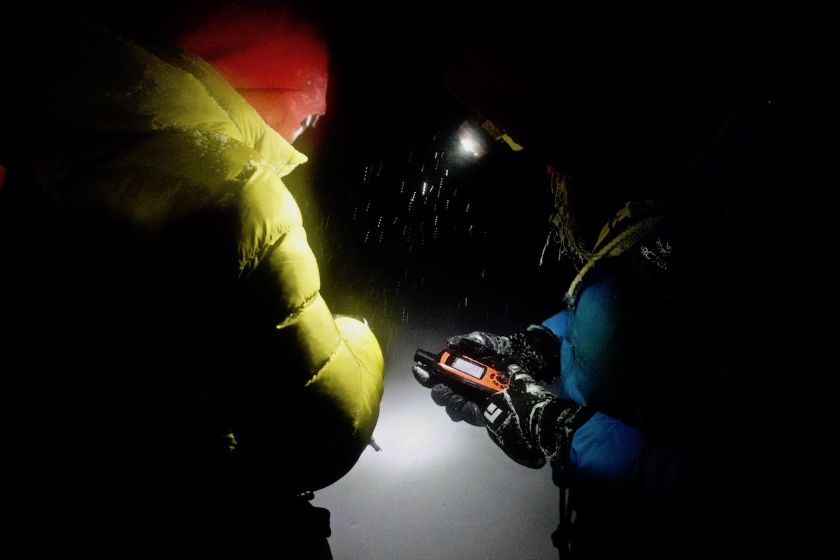 Lindic and Papert using a GPS to find the hut. [Photo] Brette Harrington