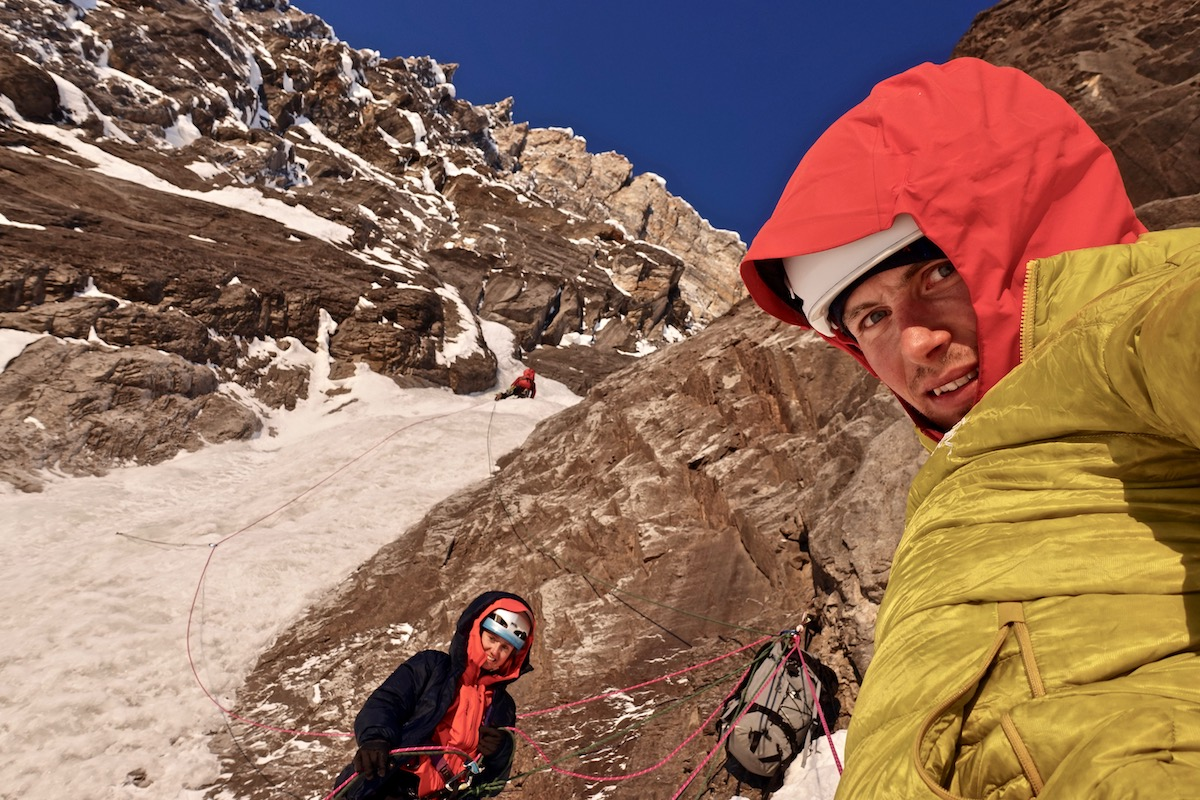Brette Harrington and Luka Lindic enjoy the first morning sun at the belay while Ines Papert leads a pitch in the middle of the wall. [Photo] Luka Lindic