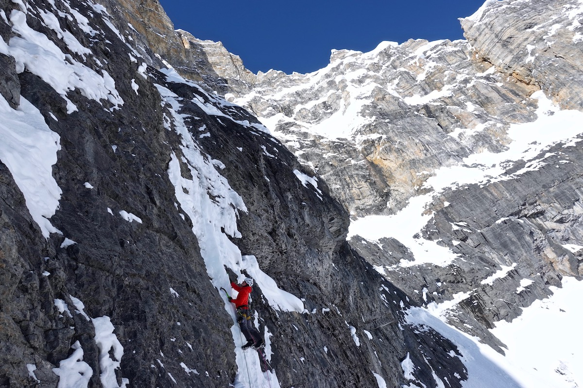 Lindic attempts to climb a column of steep snow in search of access to the headwall. [Photo] Courtesy of Ines Papert, Luka Lindic and Brette Harrington