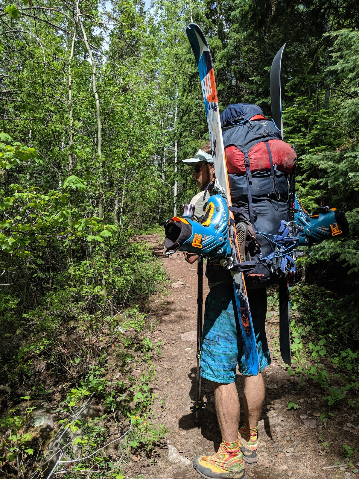 Drew Thayer carries the Osprey Mutant 52 backpack loaded with ski mountaineering gear and a large four-season tent for a climb of Mt. Daly, Elk Range, Colorado. Crampons are tied on with cord to the rear daisy chains. [Photo] Lillian Hancock