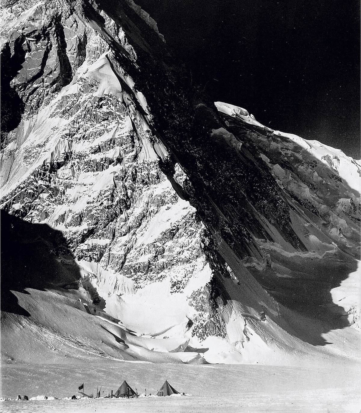 The north buttress of Mt. Kennedy as seen during the 1935 National Geographic Society Yukon Expedition. At the time, Bob Bates wrote that he hoped the peak would be called Mt. Washburn. It was known as East Hubbard until it was renamed for President Kennedy in 1965. In his years as director of the Boston Museum of Science, Washburn hung an enlarged version of this photograph on his office wall. [Photo] Bradford Washburn, Bradford Washburn collection, Museum of Science