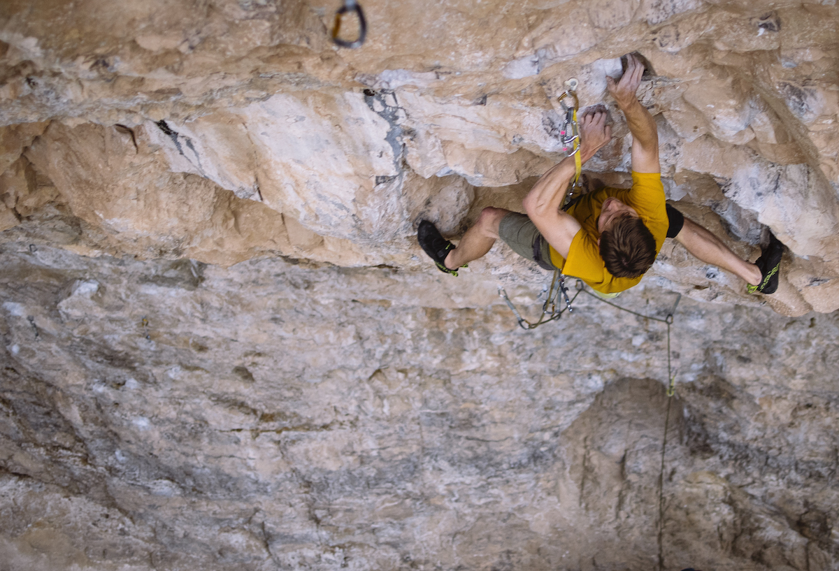 Derek Franz on Magnetar (5.13d), Rifle Mountain Park, Colorado. The Edelrid Bulletproof quickdraw is the first one clipped to the rope above the ground, near the lower right corner of the frame. The carabiner that the Bulletproof draw replaced was severely grooved. [Photo] Karissa Frye