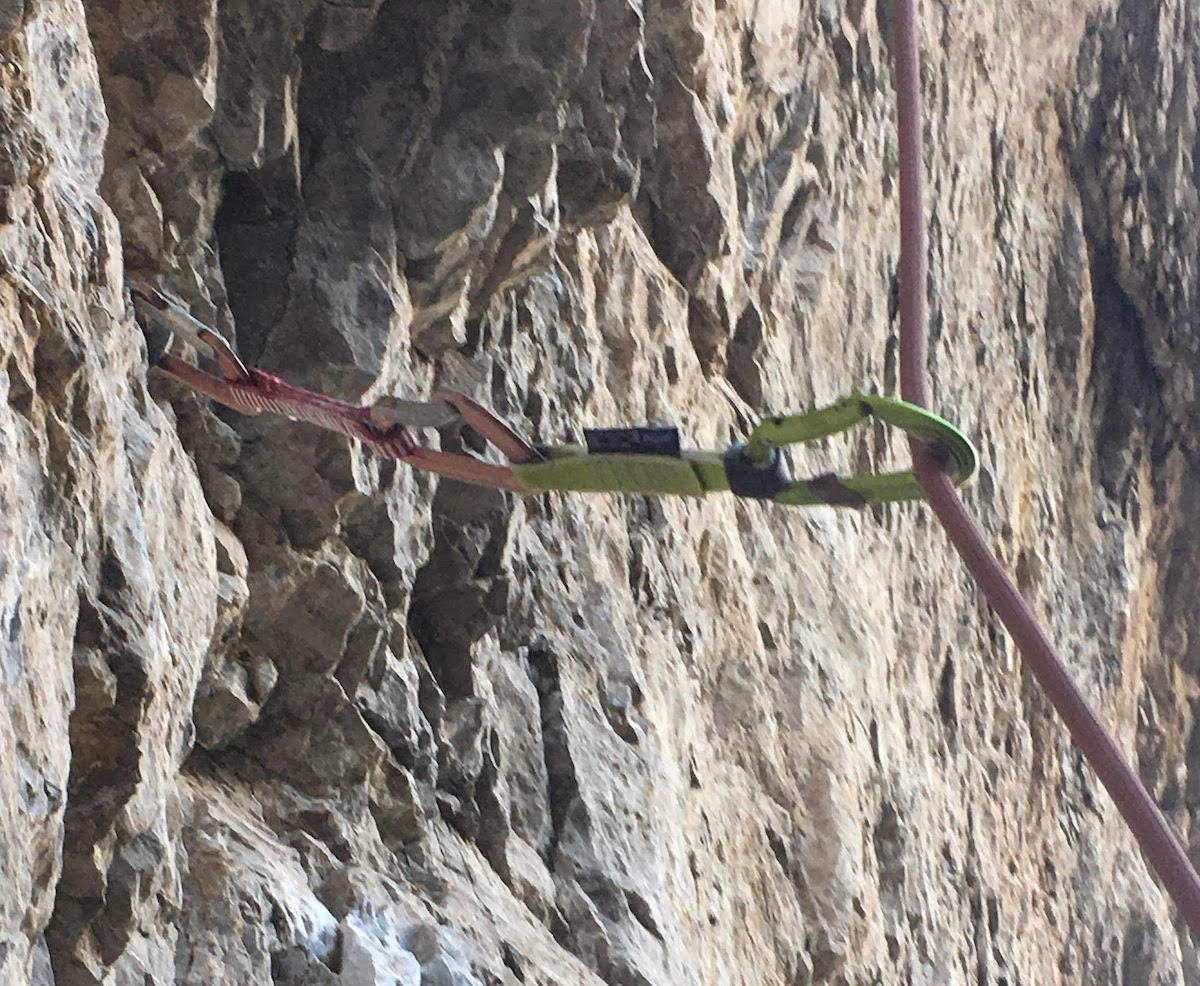 This photo shows how the angle of the rope from the belay to the first quickdraw results in more friction than if the rope were able to run straight up. Over time, this added friction causes the rope to wear a groove through aluminum (and sometimes even steel) carabiners. The Edelrid Bulletproof carabiners have a sleeve of steel to protect the softer, lighter aluminum from this kind of wear. The result is a workhorse 'biner that is much lighter than a carabiner made entirely of steel. [Photo] Derek Franz