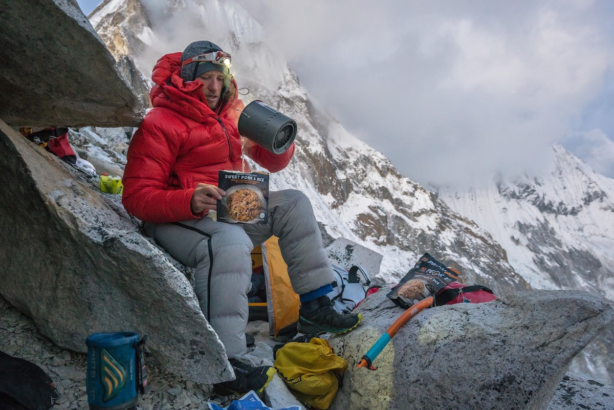 The author preparing the Peak Refuel Sweet Pork and Rice entree at Camp 1 on Ama Dablam in Nepal. [Photo] Clint Helander collection