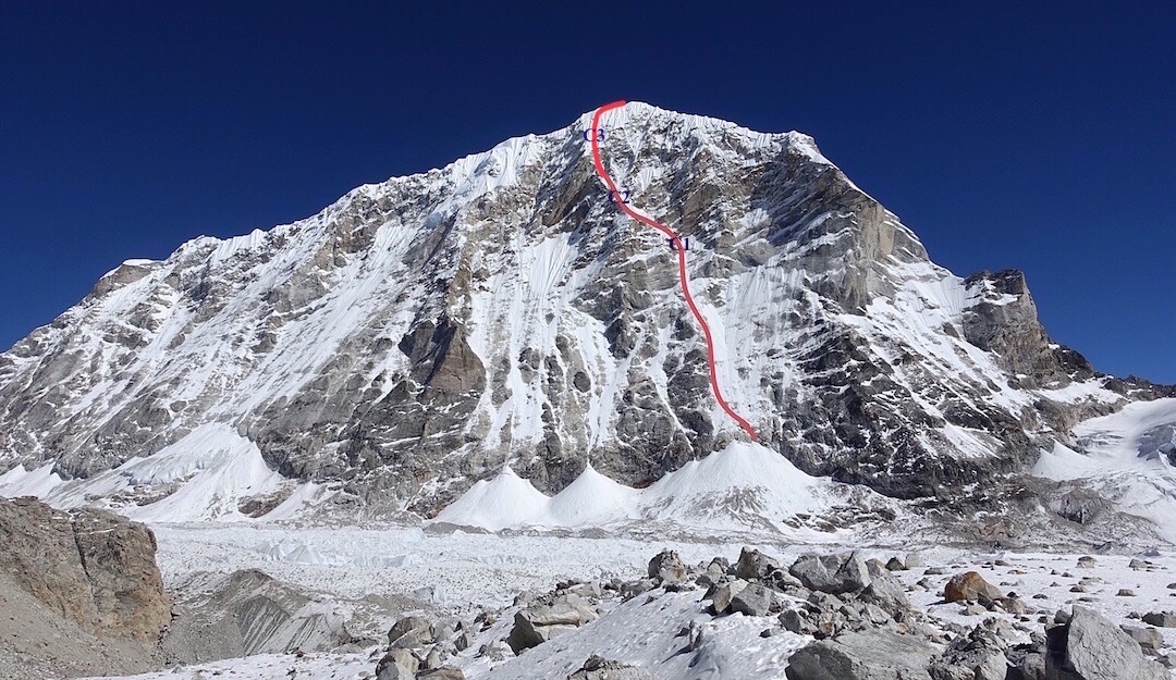 The west face of Tengi Ragi Tau (ca. 6940m) with Release the Kraken (AI5 M5+, 1600m) drawn in red. Alan Rousseau and Tino Villanueva's three bivy sites are marked in blue near the beginning, middle and top of the upper rockband. [Photo] Alan Rousseau