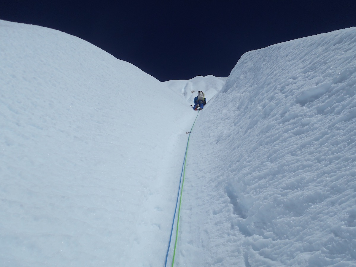 Villanueva leading in the long stretch of snow above the technical crux. [Photo] Alan Rousseau
