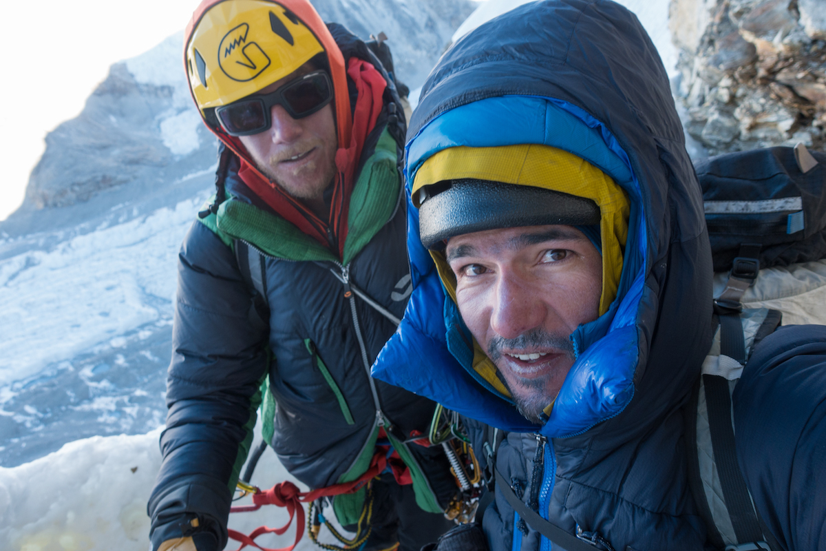 Rousseau, left, and Villanueva pause for a selfie above the last 800 meters of rappels. This was their eighth consecutive day on the move and they had run out of food the previous day after summiting. [Photo] Tino Villanueva