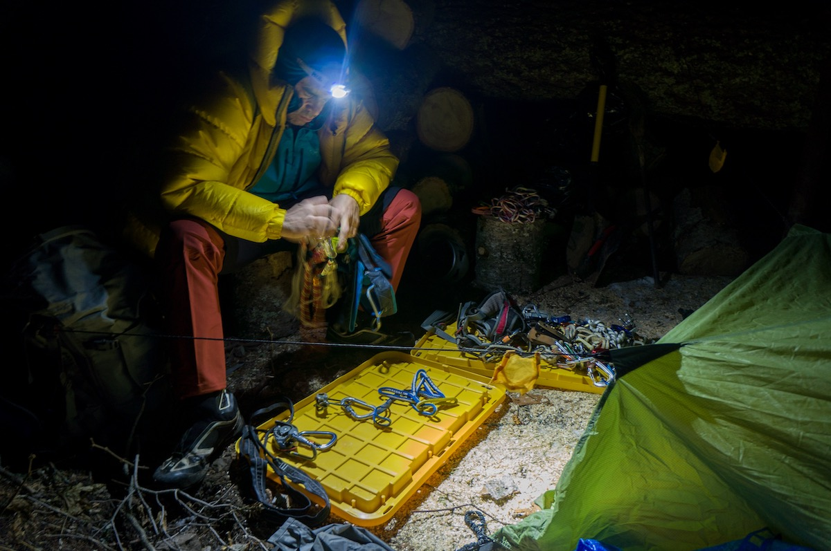 Scott Coldiron stays warm in the Valandre Troll jacket while sorting gear in the Cabinet Mountains Wilderness, Montana. [Photo] Brian White