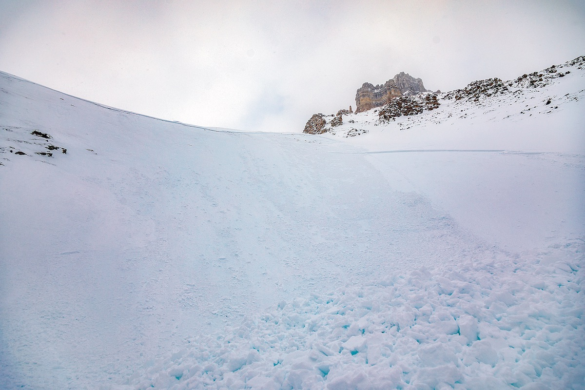 The foot-tall crown line that measured as wide as the length of two football fields delineates where the avalanche broke free on Sentinel Pass and entrenched Tim Banfield, Schumacher and Kadatz. According to Parks Canada Visitor Safety, the debris became deepest—five meters, in places—where the slope funneled and its angle flattened. [Photo] Tim Banfield