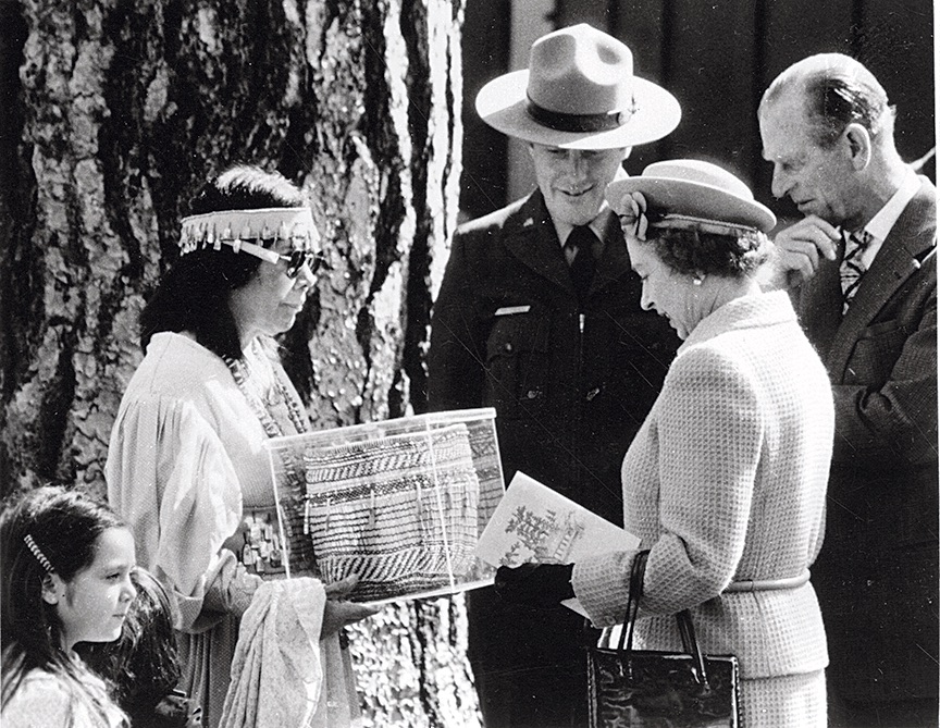 Julia Parker presents a basket she made to Queen Elizabeth II. [Photo] Yosemite Historic Photo Collection