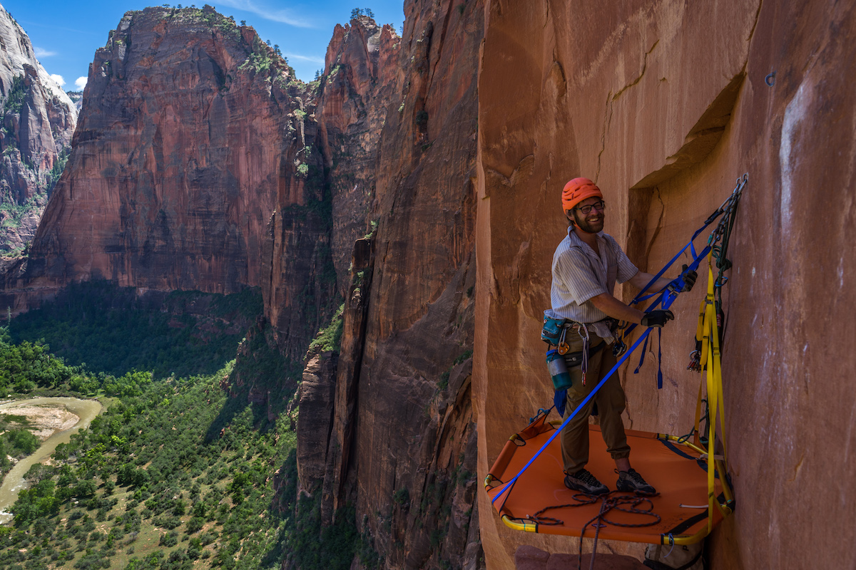 Chris Kalman enjoying the comfort of the D4 Octapod portaledge at the top of the third pitch of Moonlight Buttress (V 5.12+), Zion National Park. [Photo] Nelson Klein