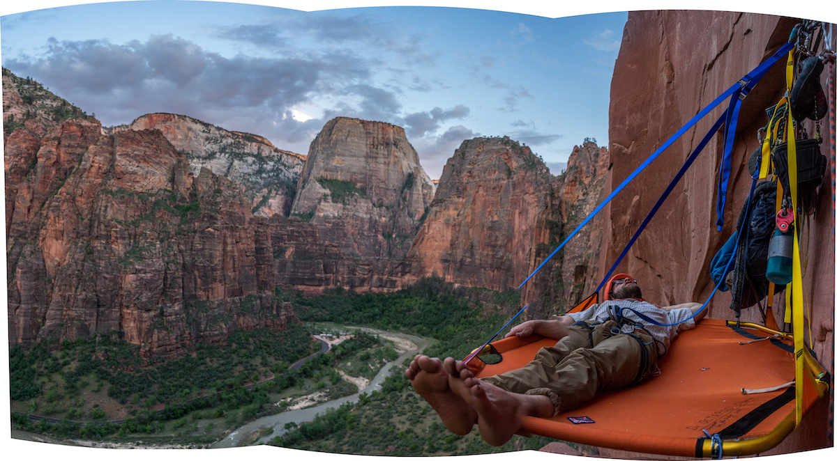 Kalman settling in for a long comfy night on the D4 Octapod portaledge. You can see that the 5-foot-5 Kalman's feet are hanging off the end. While short, the unique shape of the ledge accommodates spooning mode. [Photo] Nelson Klein