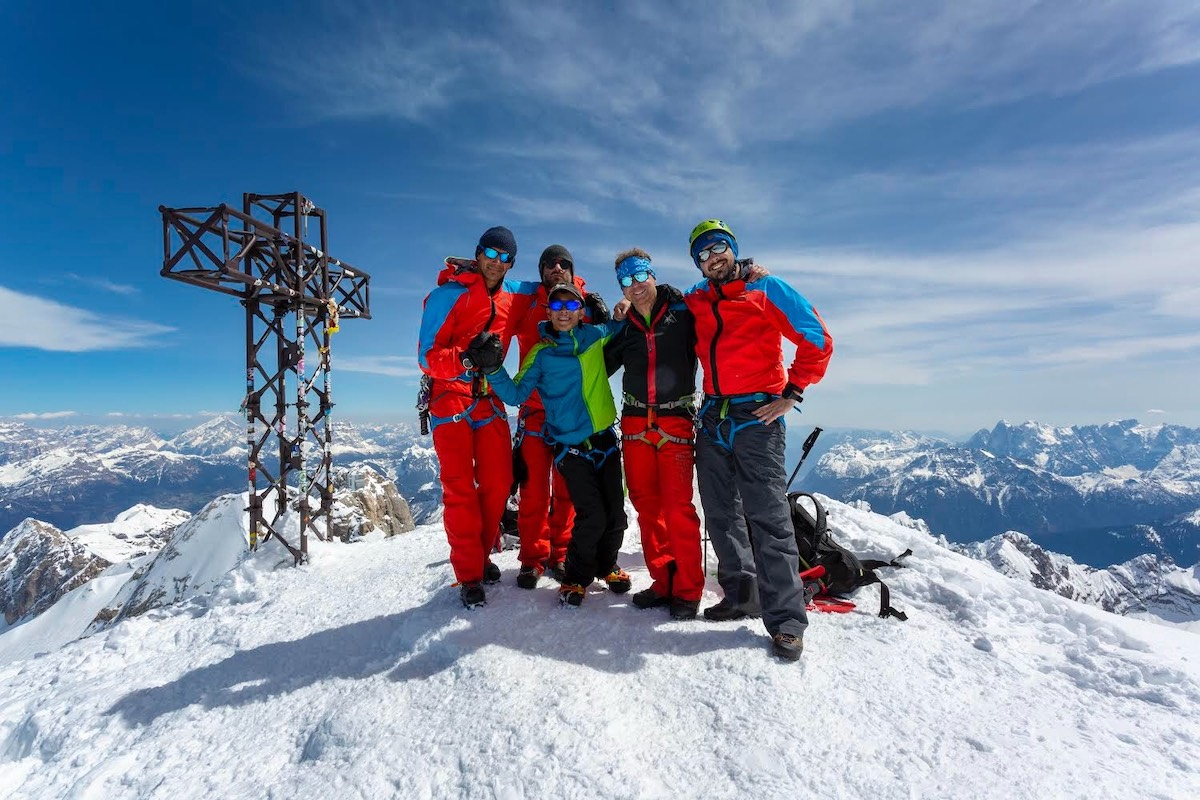Felipe with his team of guides, supporters and friends on the summit of the Punta Penia (3343m). [Photo] Stefano Fabris