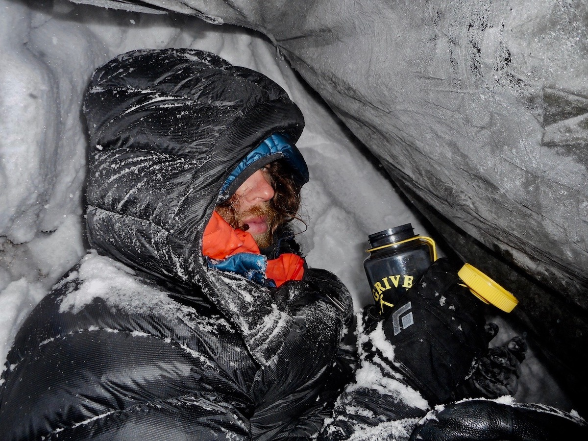 The second bivy. Rousseau writes: We gave up sleeping; this is a photo I took of Jackson while we were waiting for the sun. [Photo] Alan Rousseau