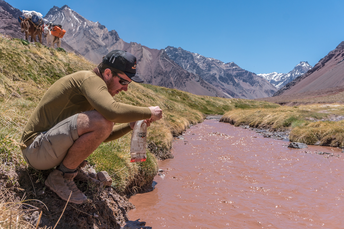 Mike Gimli Able puts the Cnoc Vecto and Versa Flow Gravity Water Filtering System to the test in the low lands of Aconcagua Provincial Park, Argentina. [Photo] Tad Mccrea