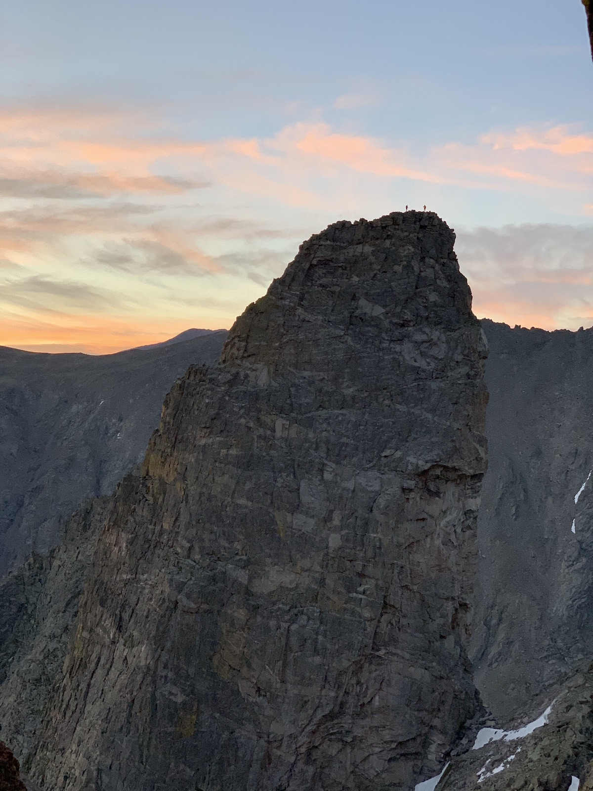 Alex Honnold and Tommy Caldwell can be seen standing on the summit of the Sharkstooth (12,630') in Rocky Mountain National Park at sunrise on Saturday, July 18, during their Continental Divide Ultimate Linkup (CDUL). [Photo] Adam Stack