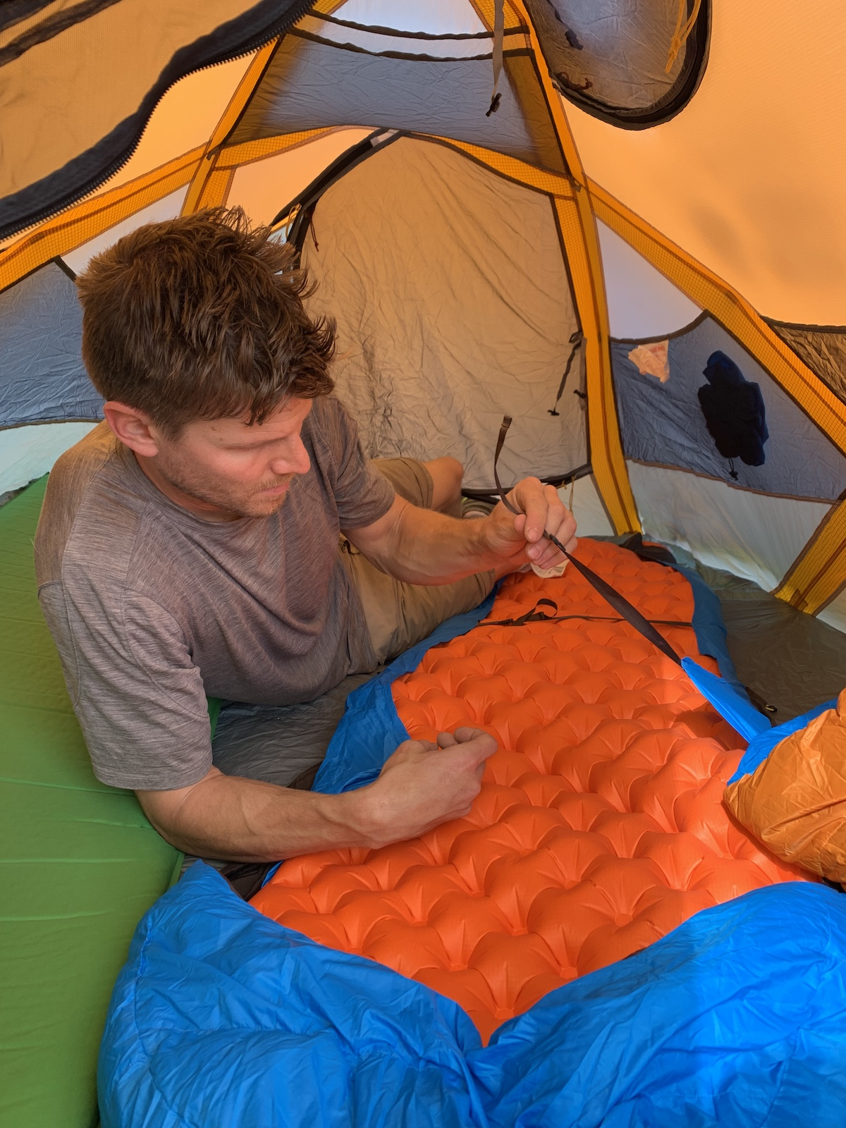 Franz attaches the Zenbivy sheet to his air mattress. [Photo] Mandi Franz