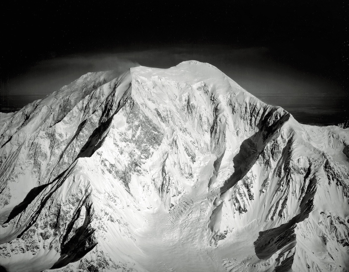 The southeast face of Mt. Foraker (Sultana). The middle and upper part of the Infinite Spur (Alaska Grade 6: 5.9 M5 AI4, 9,400', Kennedy-Lowe, 1977) rises out of the basin on the left. The Southeast Ridge, where Kennedy and George Lowe descended, is on the right. The Infinite Spur remains one of the most legendary alpine routes. [Photo] Bradford Washburn, Bradford Washburn collection, Museum of Science