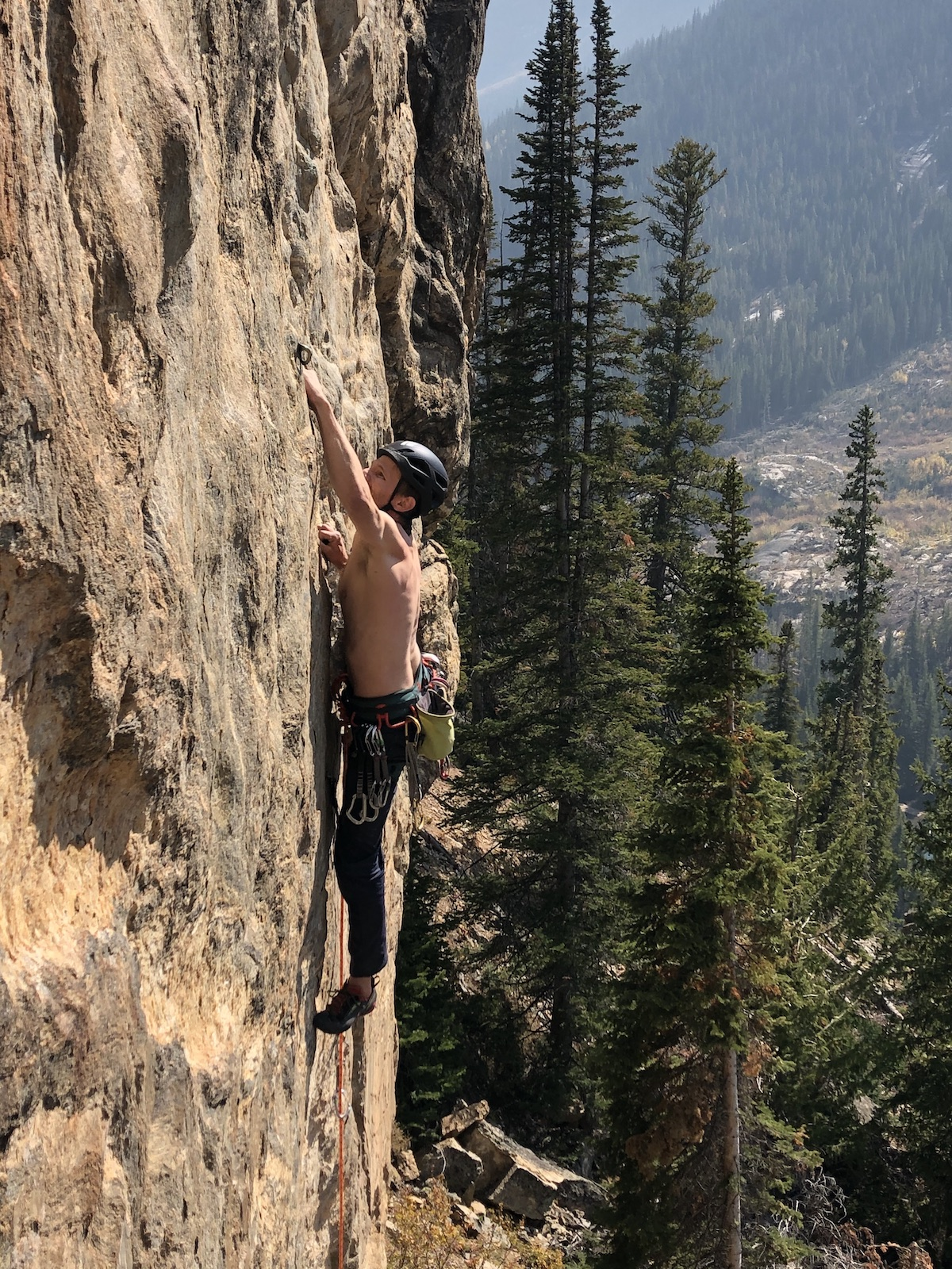 Derek Franz stays relaxed wearing the Black Diamond Vision MIPS helmet while onsighting Rock Candy (5.12a), a thin slippery route on Independence Pass, Colorado. [Photo] Elizabeth Riley
