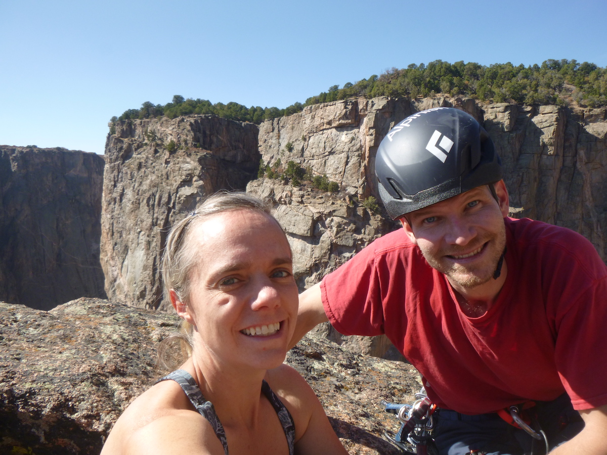 Franz with his wife Mandi on top of Maiden Voyage (5.9), Black Canyon of the Gunnison National Park. [Photo] Mandi Franz