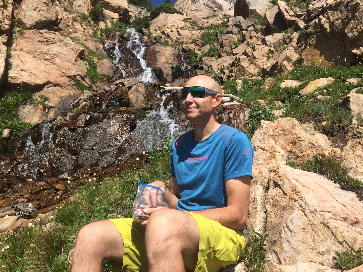 The author takes a snack break off trail in the Indian Peaks Wilderness, Colorado, while wearing the Dragon Alliance Flash LL Ions. [Photo] Catherine Houston