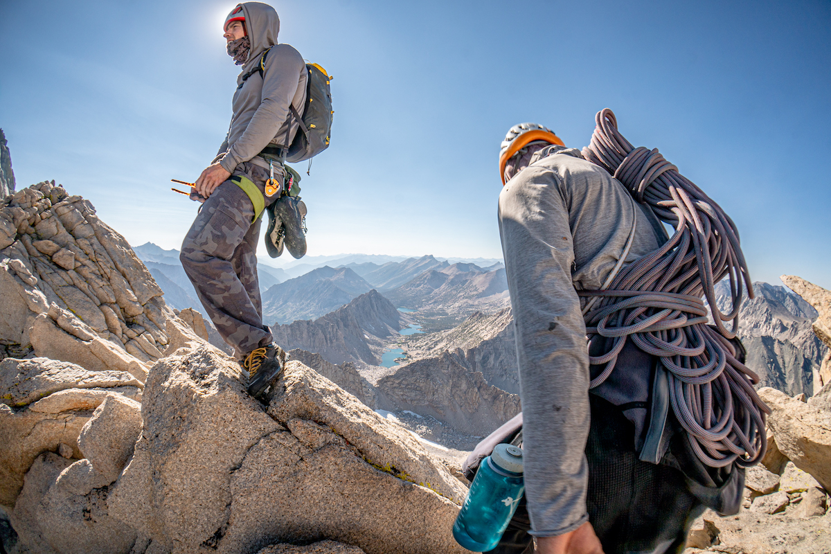 A rope...and the rack in the pack on your back! The Alien's svelte design saves not only weight, but tremendously reduces the volume of gear you need to shove in your pack as well. Luke Potter and Chip Powell stash the kit and make a break for the summit of University Peak after climbing Liberal Arts. [Photo] Tad McCrea