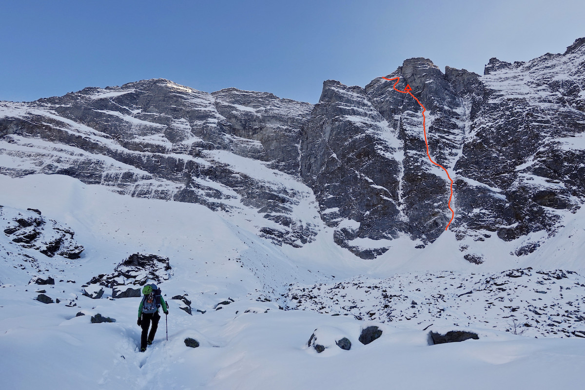 Approaching the north face of the Sagwand, Valsertal, Austria. The red line shows Papert and Lindic's new route Limited in Freedom (AI6 M6, 800m). The location of their bivouac is marked with a triangle near the top. [Photo] Luka Lindic
