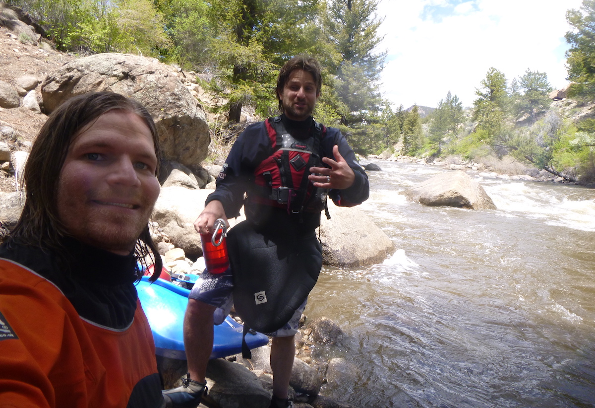 Franz celebrates with his longtime kayaking buddy Brian Wright after completing a clean run on the famous Class IV Numbers section of the Arkansas River, Colorado, June 1, 2015. Wright, who now lives in Alaska, has also been using the Ombraz sunglasses and agrees that they have excellent utility. Franz and Wright have been paddling together since they got their driver licenses in high school. [Photo] Derek Franz