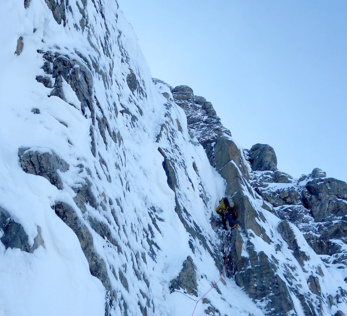 Hawthorn excavating a snow-choked dihedral near the Emperor Ridge. [Photo] Ethan Berman