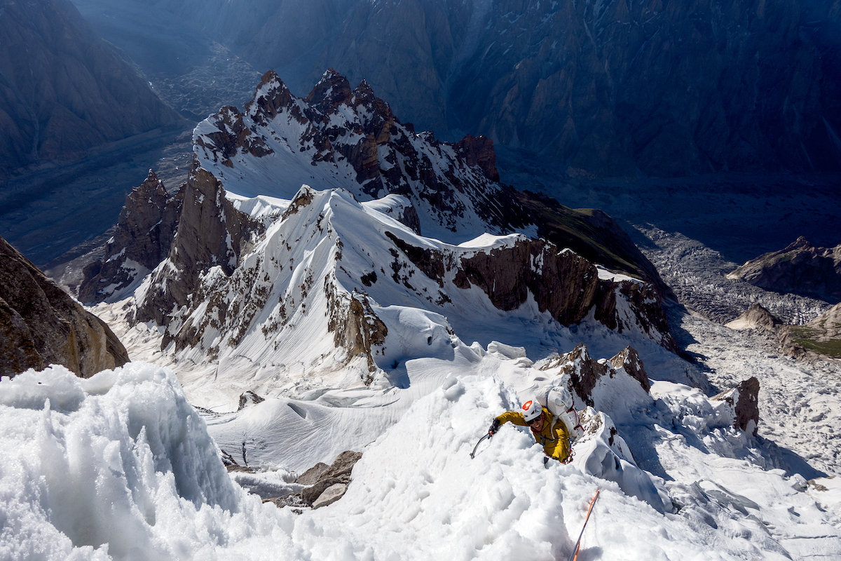 Chris Wright climbs through a snow ridge marking the top of the initial steep mixed band on the southeast face during the first ascent of Link Sar (7041m) with Mark Richey, Steve Swenson and Graham Zimmerman. [Photo] Graham Zimmerman