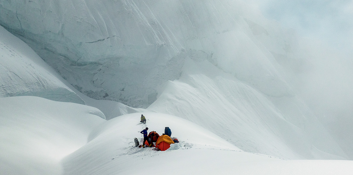 The team prepares for a 36-hour storm at Camp III on Link Sar. [Photo] Graham Zimmerman