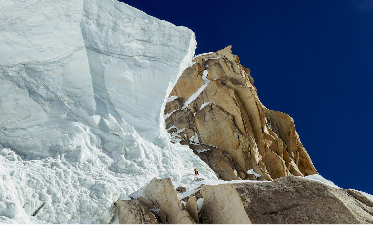 Approximately 1000 meters beneath the summit, Wright leads toward the serac that presented a major obstacle to the team's ascent. They eventually overcame the feature by climbing around and then behind the hanging ice. [Photo] Mark Richey