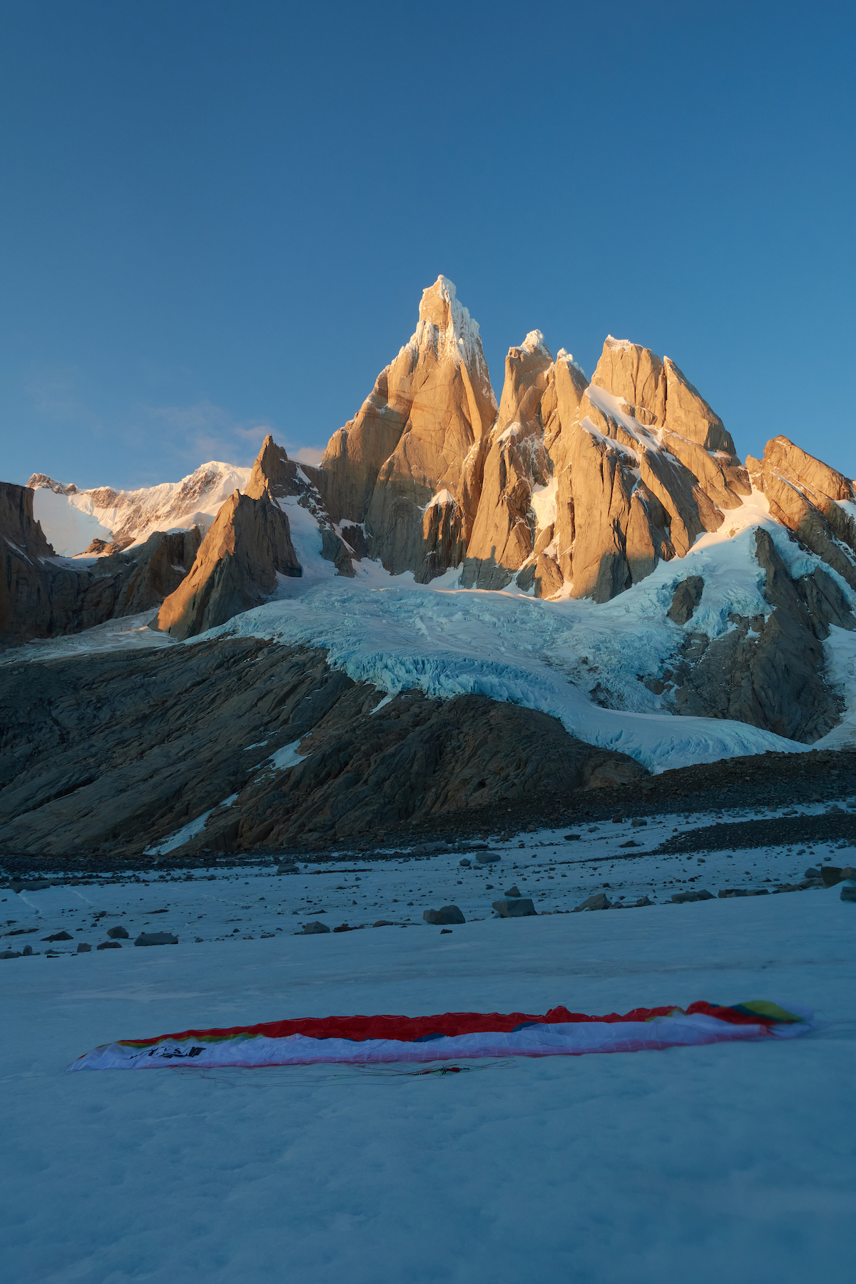 A safe landing after paragliding from the summit of Cerro Torre. [Photo] Courtesy of Fabian Buhl