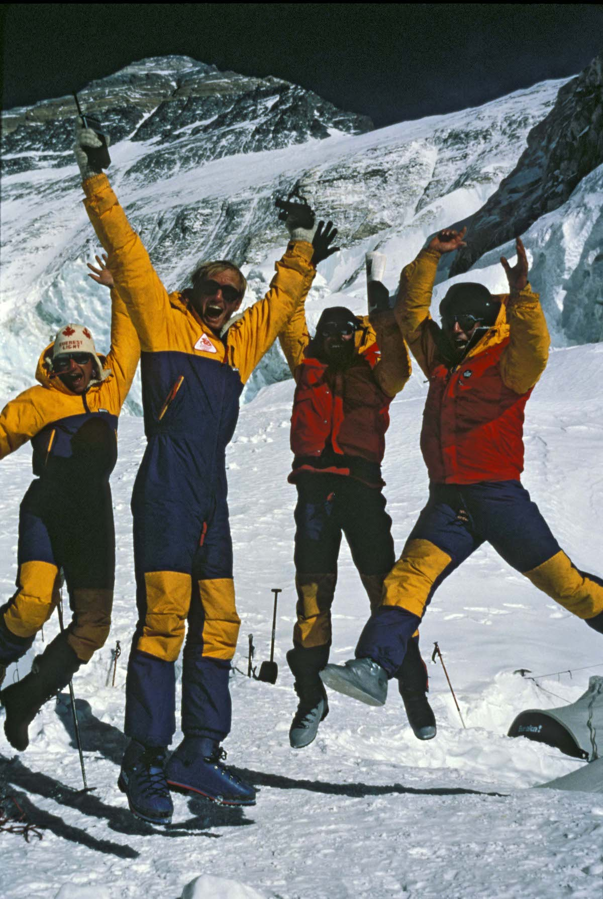 Everest Light Team celebrates after summit news. [Photo] Chris Shank, courtesy of Mountaineers Books