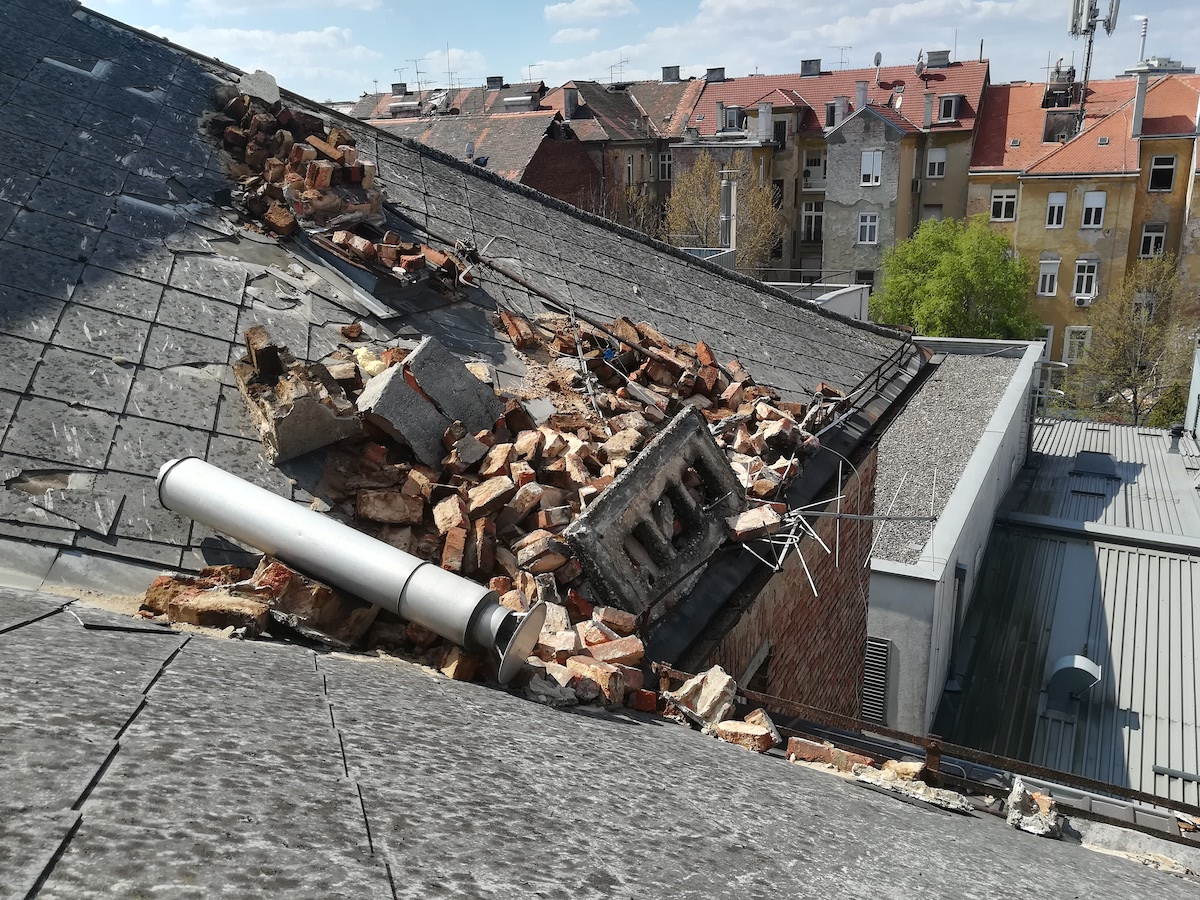 The rooftop rubble of a chimney that was toppled during the earthquake. [Photo] Vanja Siljak