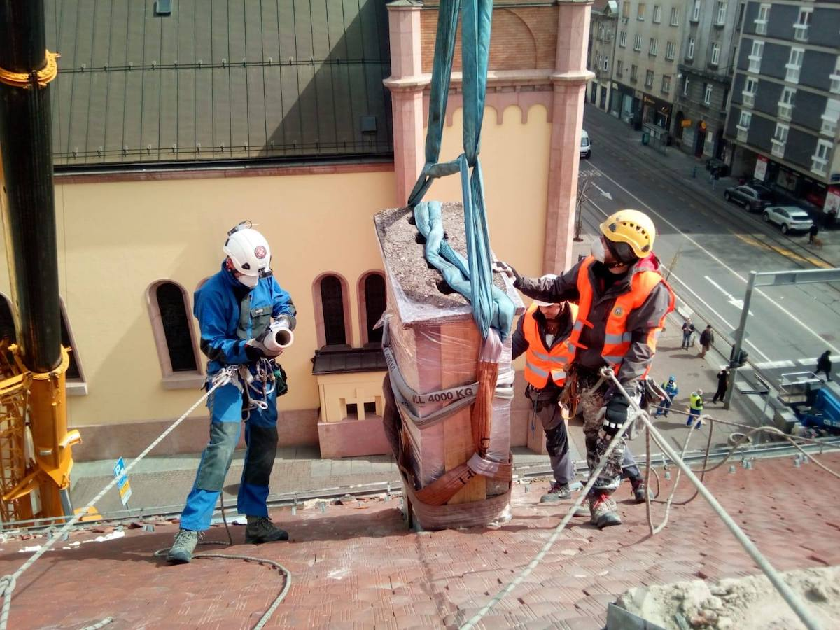 Jagor Koprek and two unidentified volunteers remove a damaged chimney above Vlaska Street in the center of Zagreb, Croatia. Koprek is one of the organizers of the volunteer movement to help clean up dangerous debris from city rooftops after the March 22 earthquake that rocked the country's capital. [Photo] Ivica Sturlan
