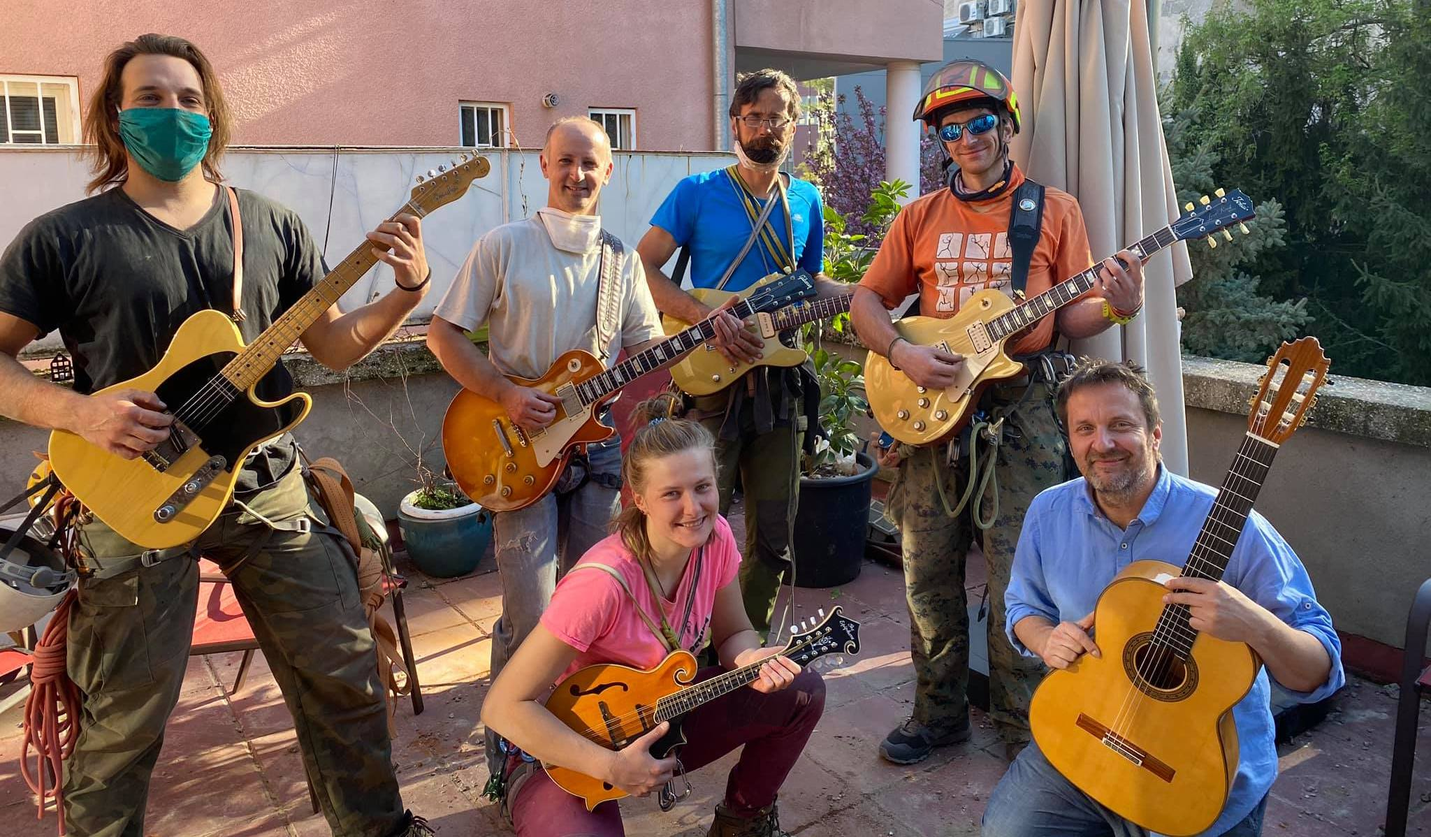 Well-known Croatian jazz musician Ante Gelo (lower right) poses with volunteers who cleared his roof from the loose material. Gelo played for them while they were working on the roof and showed them a collection of his fine guitars. [Photo] Courtesy of Ante Gelo