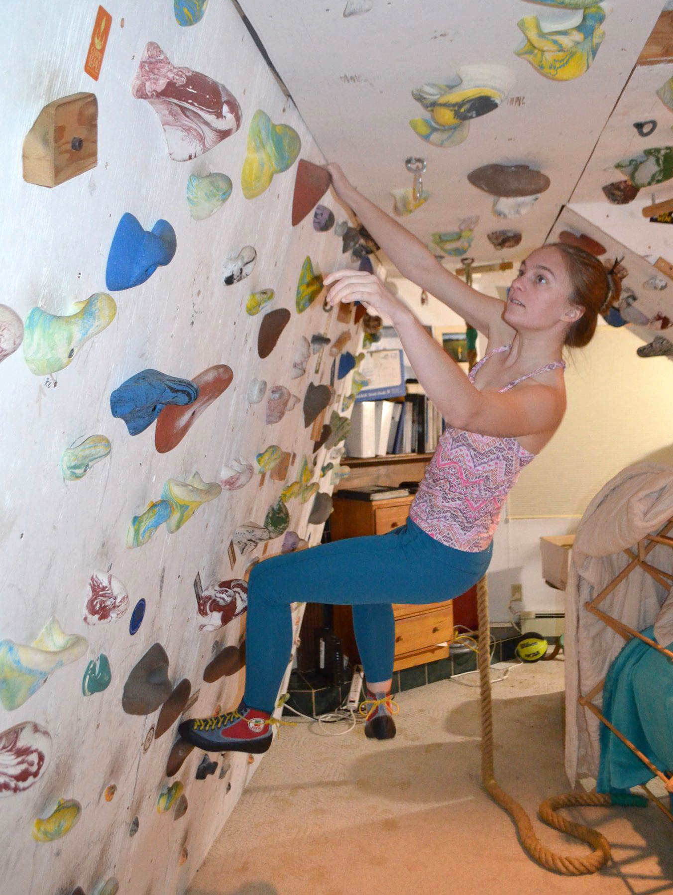 Zoe Burns sending Laundry (V2) on her home wall in Basalt, Colorado. Scientists are encouraging climbers to refrain from climbing popular outdoor routes because the coronavirus can remain infectious on a variety of surfaces, including rock, for significant periods of time. [Photo] Cam Burns