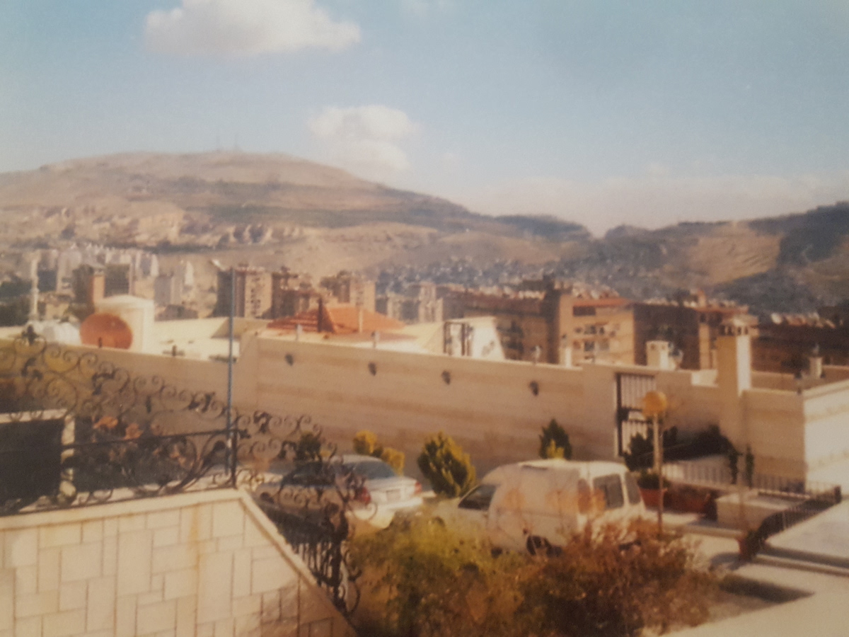 Dummar, Syria, where the author grew up. The hill in the background on the left is Mt. Qasioun and the one partially visible on the right is Mt. Mezzeh. [Photo] Suzana EL Massri family collection