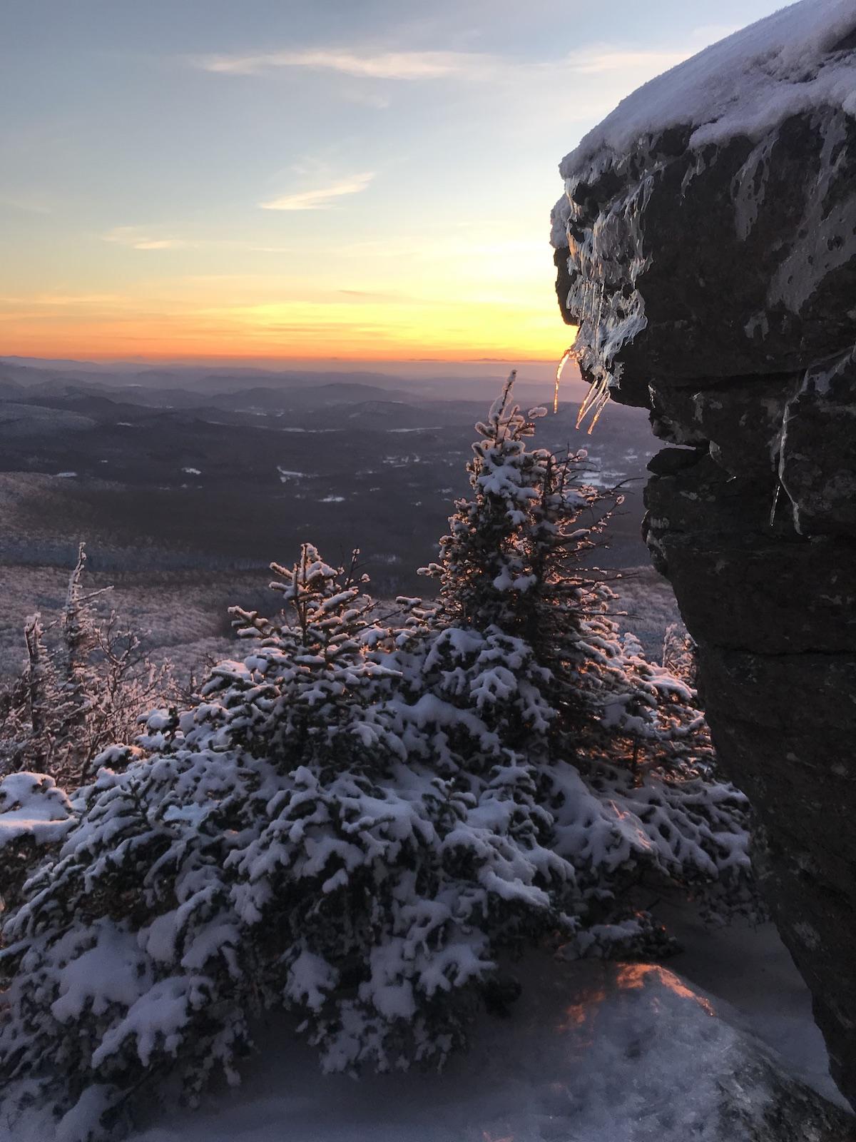 Sunset from the flanks of Mozodepowadso (Abenaki name for Mt. Mansfield), Green Mountains (Askaskwiwajoak), Vermont, Abenaki territory. [Photo] Katie Ives