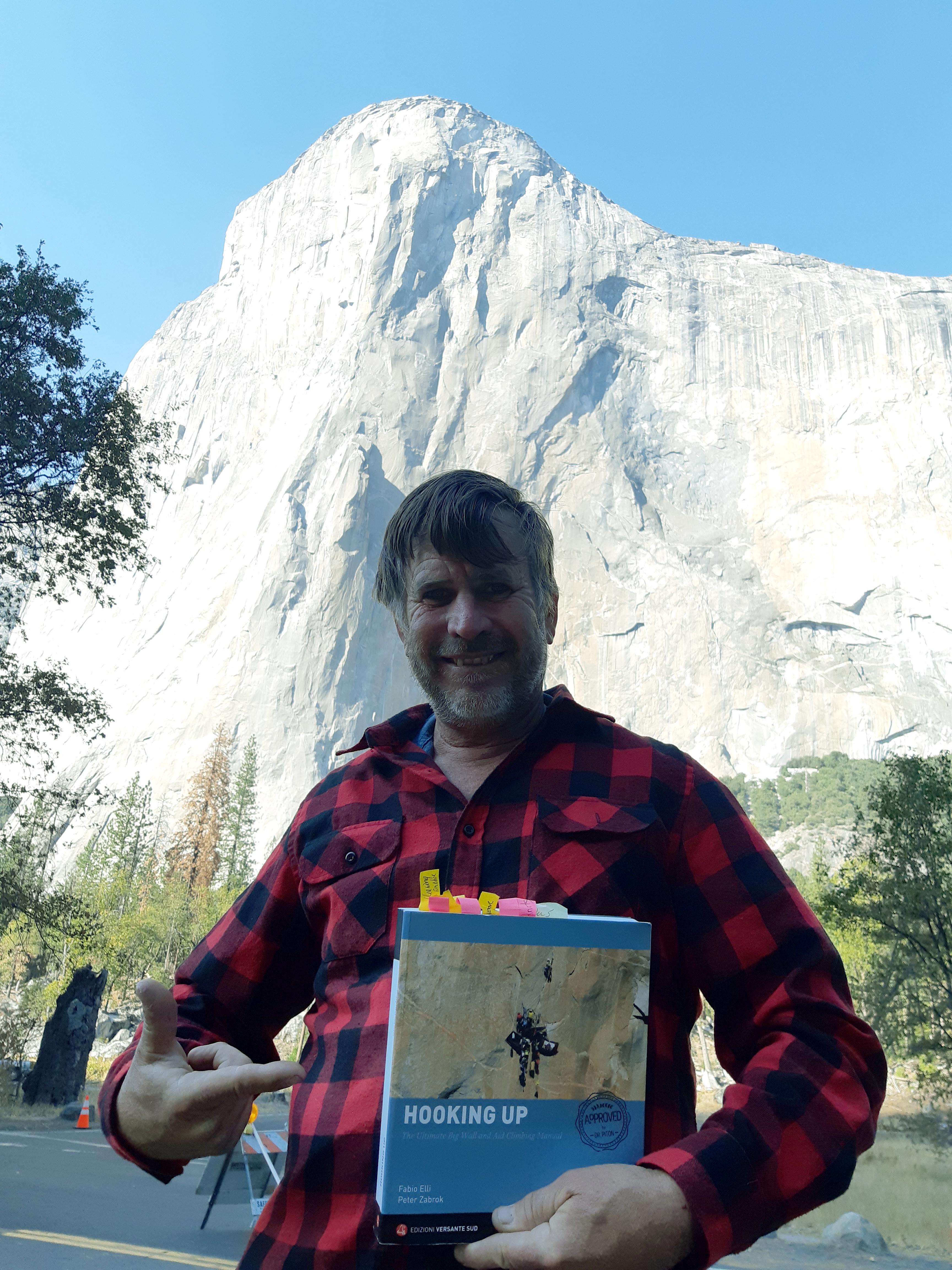 Zabrok with his book below El Cap (Tu-Tok-A-Nu-La). [Photo] Peter Zabrok collection