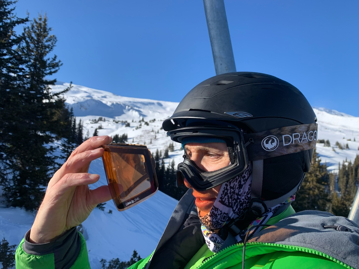 Lewis changes his PXV2 lenses on the ski lift without even taking the goggles off his head. [Photo] Catherine Houston