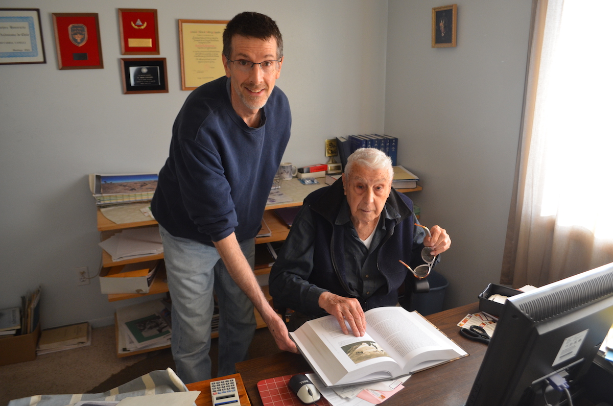 Echevarria (right) in his home office in Loveland, Colorado, October 2018, with his son Felipe. [Photo] Cameron M. Burns
