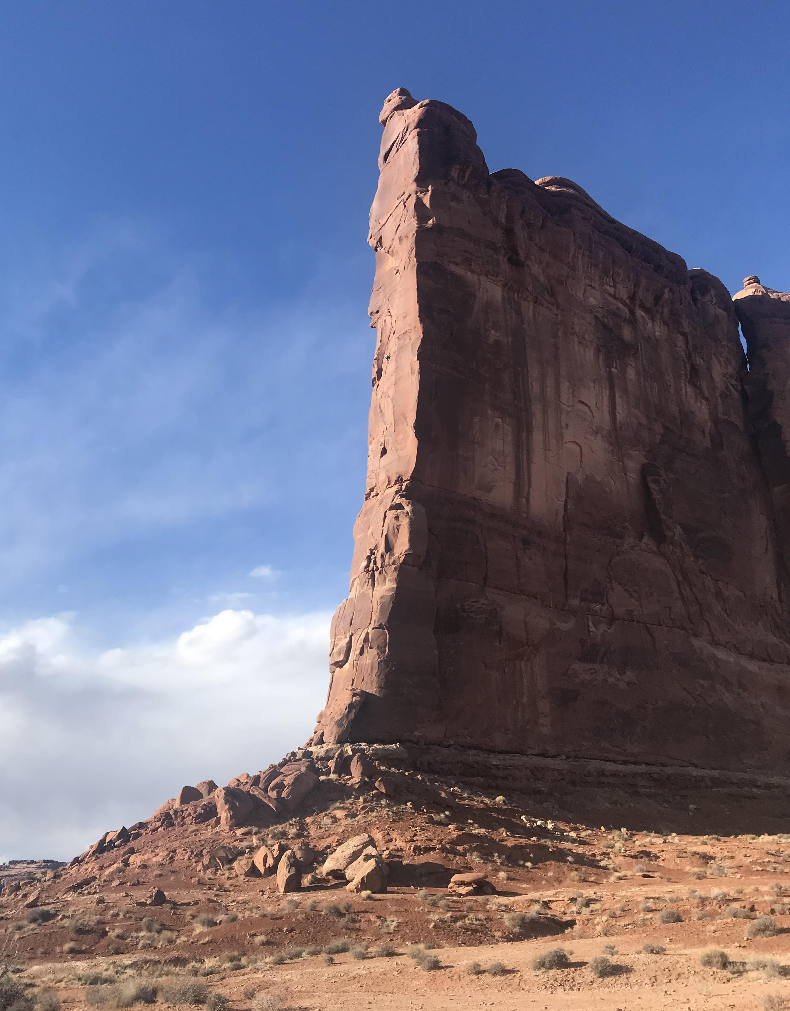 The author can be seen as a tiny dot in middle of the prow, halfway up the Tower of Babel in Arches National Park during his solo ascent of Zenyatta Entrada (5.8 C3-, 450') in February (Anasazi, Hopi, Navajo, Ouray, Paiute, Uintah, Ute, Zuni land). [Photo] Mikenna Clokey