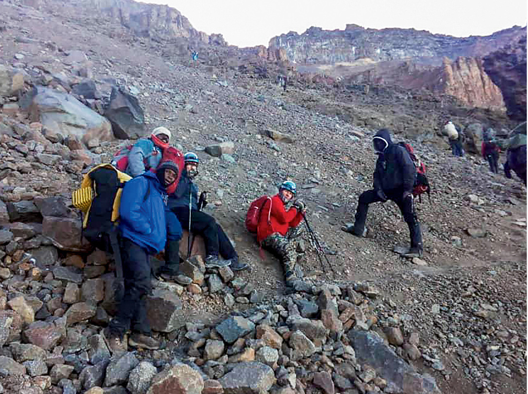 A group of climbers with Barnabas on the way to Crater Camp via the Western Breach route. [Photo] Lukiano Barnabas